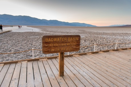 A wooden sign at Badwater Basin indicates its elevation is 282 feet below sea level.