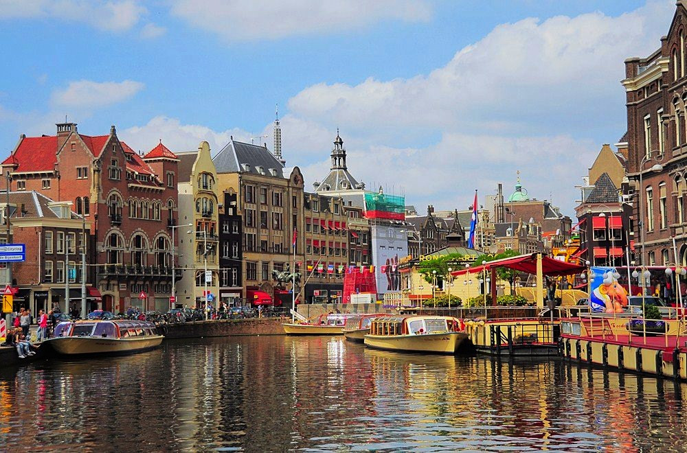 colorful picture of amsterdam taken from a canal