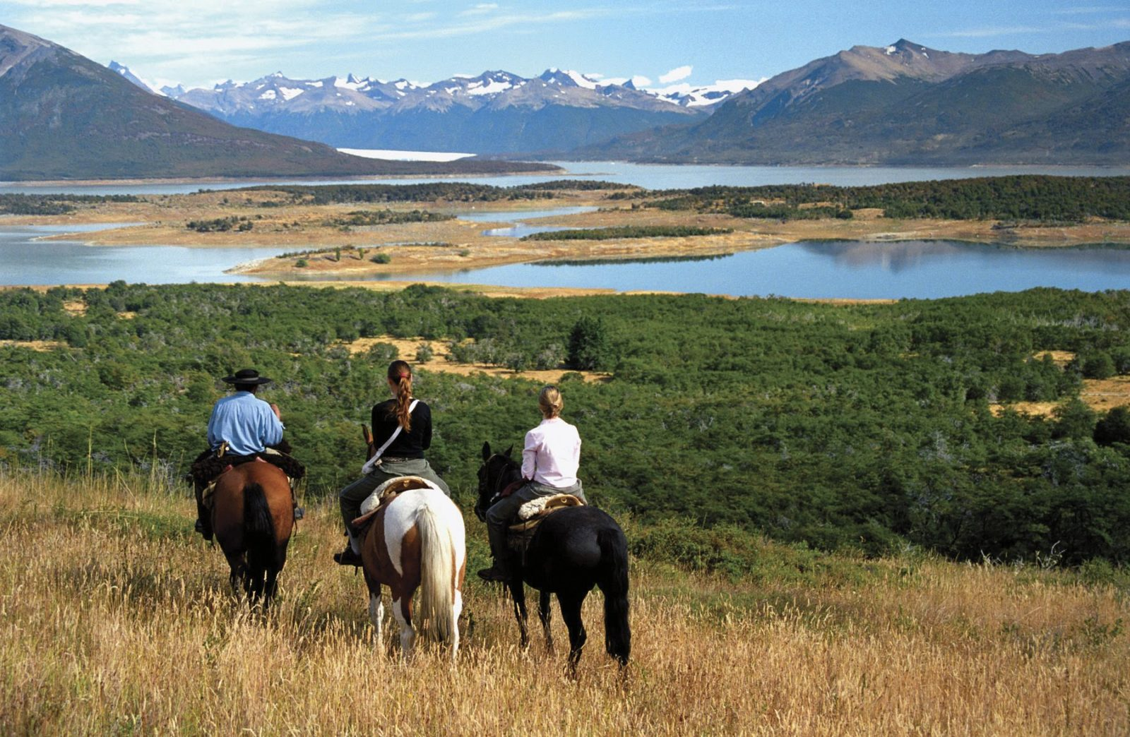 family on horses looking at mountains in patagonia