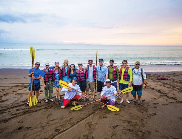 A group holds their paddles after exploring on a costa rica family vacation