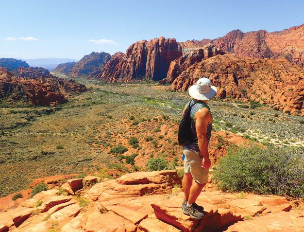 A man peering out at Utah on her Zion National Park to Bryce Canyon Adventure