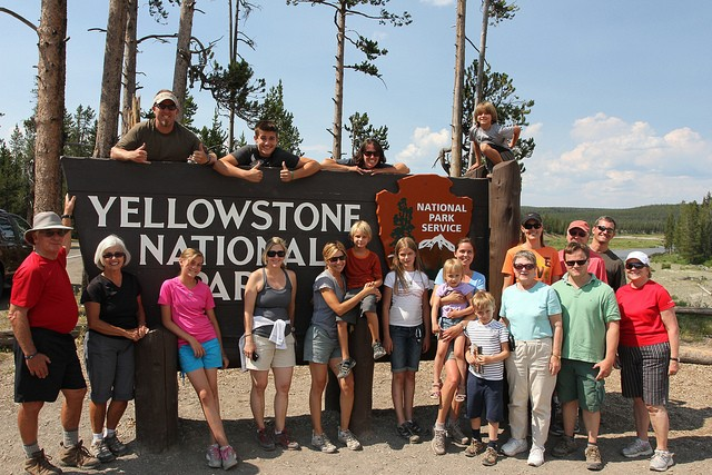 Group photo at the Yellowstone National Park sign near Jackson Wyoming