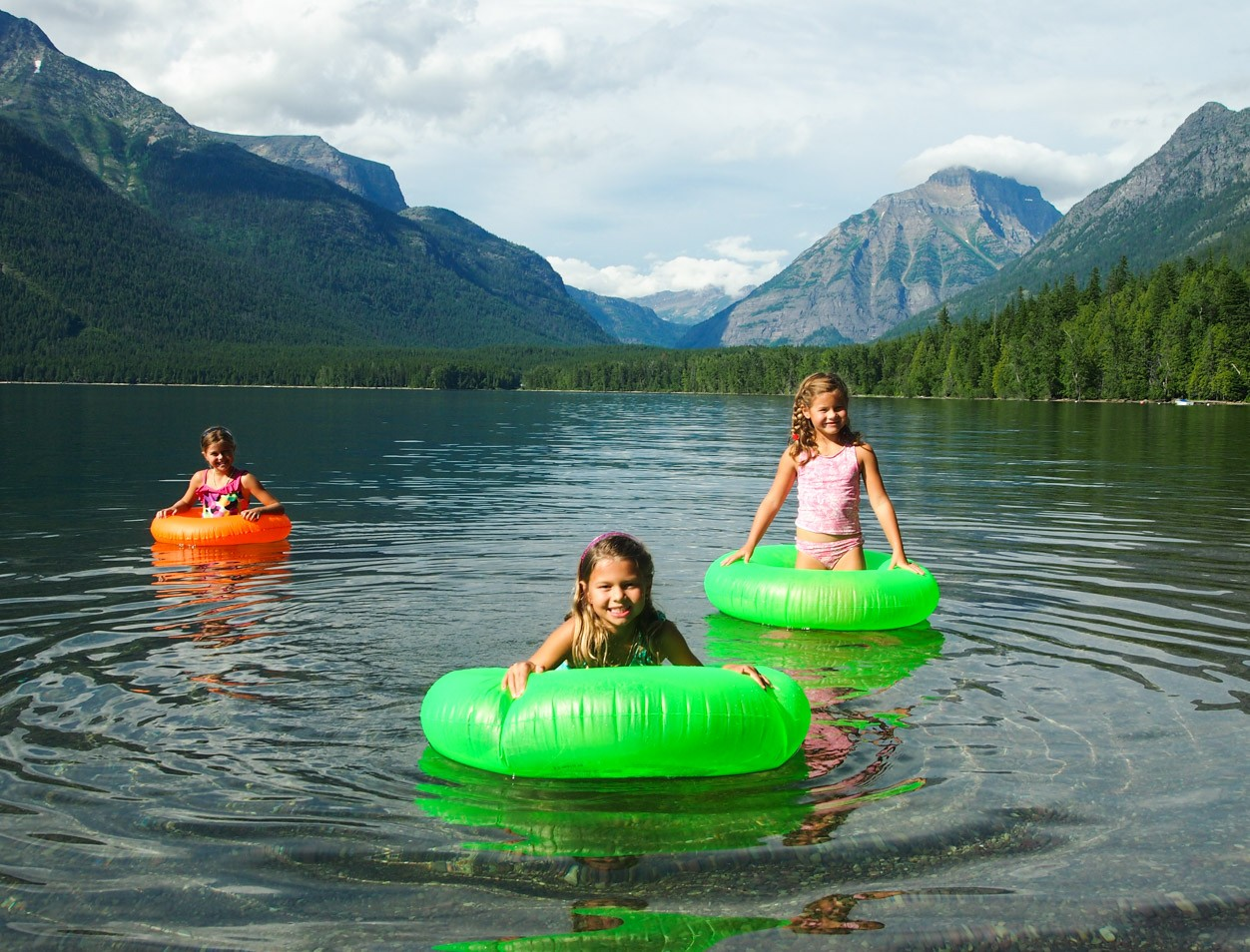 Kids enjoying tubing on Lake McDonald in Glacier National Park
