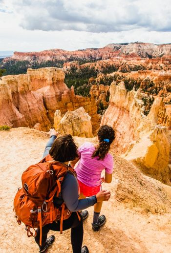 mom & daughter enjoy view at top of bryce canyon on their utah family vacation