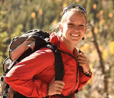 Kasey Austin wearing a backpack. Find your adventure travel with her.